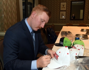 Bobby Bragan Collegiate Slugger Award winner Hunter Hargrove signing hats. (photo by Bob Haynes)