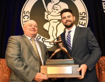 Tracy Taylor, left, Executive Director for the Bobby Bragan Collegiate Slugger Award poses with the 2018 award winner Devlin Granberg of Dallas Baptist University, right, s holds the trophy at the Fort Worth Club in Fort Worth, Texas, Thursday, November 1, 2018. Special/Bob Haynes