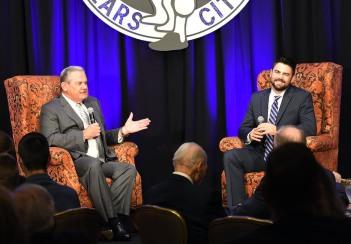 Steve Busby interviews Devlin Granberg. (photo by Bob Haynes)