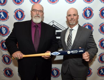 Tony Rodges and brother Scott with bats