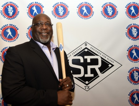 Former Texas Ranger Mark McLemore, holds a bat while attending the Bobby Bragan Collegiate Slugger Award Watch List Announcement, Monday night February 11, 2019 in Fort Worth Texas.